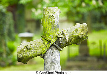 Cemetery - Cross on the grave - selective focus