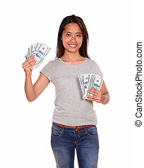 Smiling ethnic young woman with cash dollars