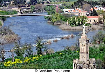 Aerial view of Toledo, Spain with River Tajo and Statue of...
