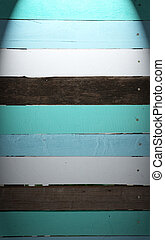 Vintage wood panel background with spot light.