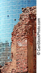ruins wall on the background of modern skyscrapers