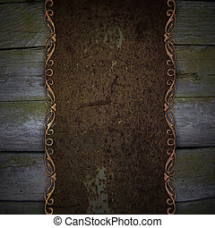 wooden background with rust metal plate
