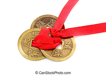 Three Chinese coins tied with red ribbon - Three Chinese...