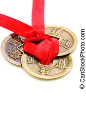 Three Chinese coins close up - Three Chinese coins tied with...