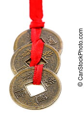 Three Chinese coins. - Three Chinese coins tied with red...