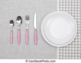 empty plate with fork, spoon and knife