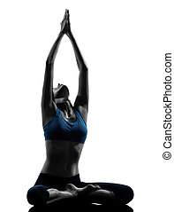 woman exercising yoga meditating sitting hands joined - one...