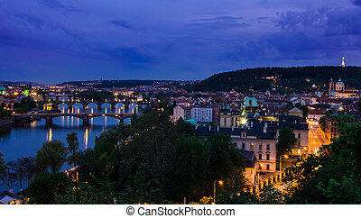Vltava river and bridges in Prague after sunset