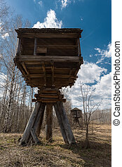 Hut built on piers, outdorrs shot, Kostroma, Russia