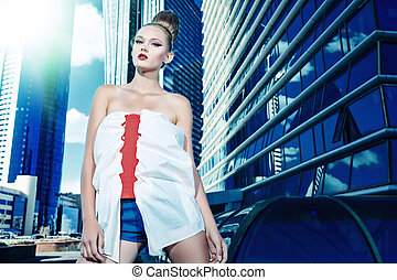 haute couture - Fashion model posing over big city...