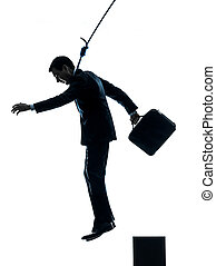 business man suicidal hanging silhouette - one caucasian man...
