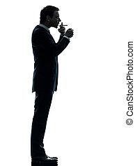 man smoking cigarette silhouette - one caucasian man smoking...