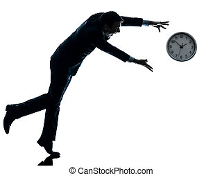business man running after clock silhouette - one caucasian...