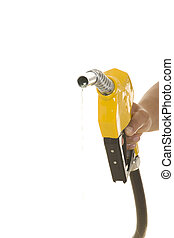 yellow gas pump - Male hand wasting gas with yellow pump...