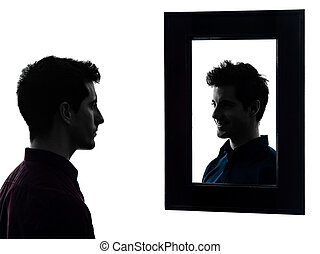 man serious in front of his mirror silhouette - man in front...