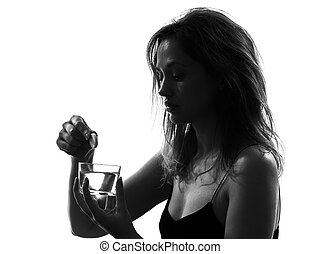 woman taking effervescent medicine portrait silhouette