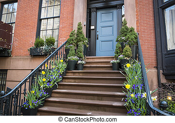 Stairs to a doorway of an old apartment, New York City -...