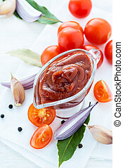 Traditional homemade tomato sauce with ingredients on light...
