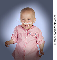 Adorable baby without hair beating the disease isolated on...