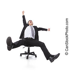Successful excited Business man sitting in chair, young...