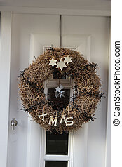 Modern door with christmas wreath