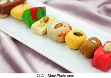 Colorful Indian sweets in the plate