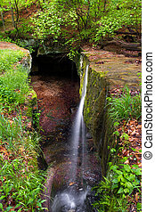 Rock Bridge Waterfall - A small, graceful waterfall pours...