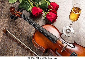 Violin, rose, glass of champagne and music books, still life