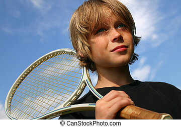 Ready to compete - Closeup of boy playing tennis against a...