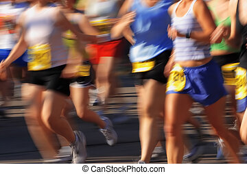 Marathon in camera motion blur - Runners streak past the...