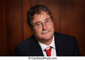 Middle Aged Businessman - A business man smiles at the...