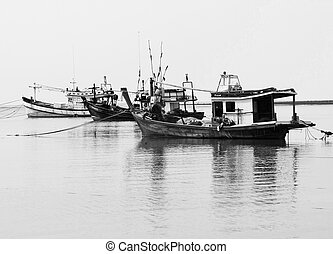 Black and white seascape of fisherman boat