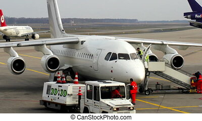 a plane gets ready for departure at koln bonn airport