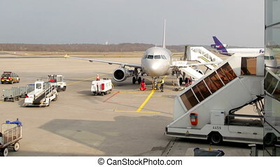 a plane gets ready for departure at bonn / koln airport, germany