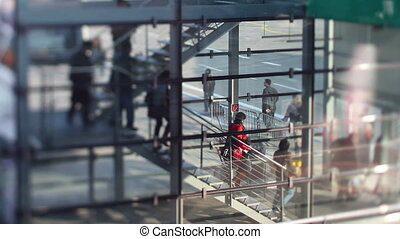 passengers walking down stairs about to board a flight at...