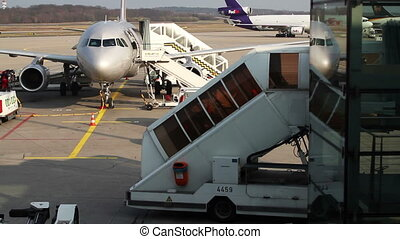 a plane gets ready for departure at koln bonn airport, germany
