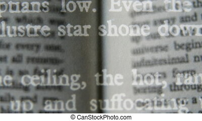different layers of close-up of different pages of a book