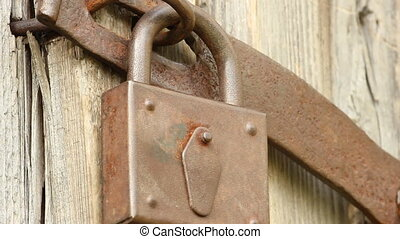 Old padlock on the door of the shed