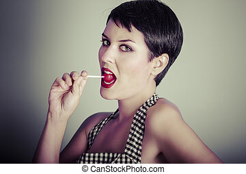 Vintage woman eating a lolly pop