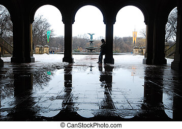 winter at central park - arches near bethesda fountain at...