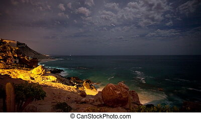 timelapse of a wild coastal scene at night in cabo san lucas, mexico