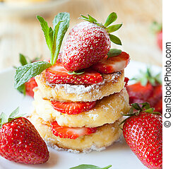 stack of homemade curd pancake with strawberry slices, food...