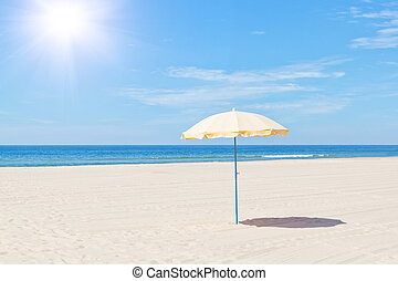 The only beach umbrella on the sea in summer under the sun
