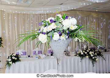 Wedding reception centrepiece - White and violet flowers...
