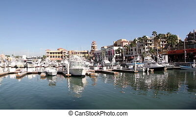 shot of the port and boats in cabo san lucas, mexico
