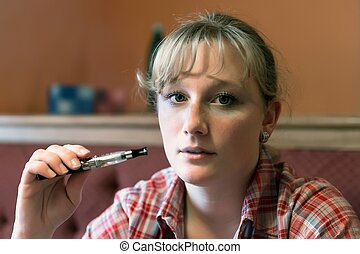 Young beauty girl with e-cigarette - Woman smoking with...