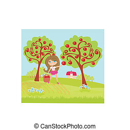 A little girl collects apples in sunny day