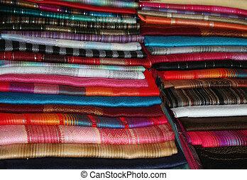 Stacks of Colorful Shawls - Stacks of handmade colorful...