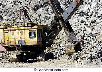 power-shovel - A power-shovel works in a career