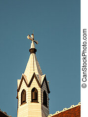 church steeple - Church steeple and wooden cross against a...